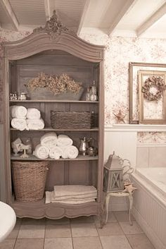 This amoire, and it's taupe color, (with or without doors), is fabulous in the bathroom along with the great accents on the shelves!  <3  And, I like the ceiling, BUT THAT'S IT. (I do not, do not, like the old-fashion wallpaper nor tub or floor.)