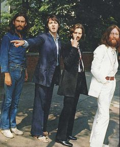 The Beatles waiting to cross Abbey Road during the shooting of the legendary album cover