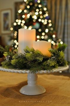 5 Simple DIY Holiday Centerpieces - Dariela Cruz - Mami Talks - 5 Simple DIY Holiday Centerpieces Use your cake plate to decorate! Add some greenery, pine cones and candles and you have a rustic chic DIY centerpiece! Holiday Centerpieces, Christmas Table Decorations, Decoration Table, Holiday Decor, Centerpiece Ideas, Graduation Centerpiece, Wedding Centerpieces, Decoration Crafts, Quinceanera Centerpieces