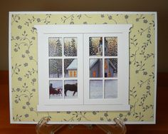 great idea - recycling a scene from an old Christmas card as the view outside of a window