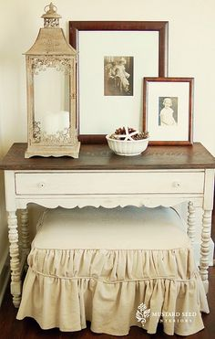 Love how she took a little desk and refinished it and then recovered an ottoman for this look. Small, but functional!