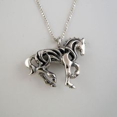 Detailed Dressage Piaffe Horse Necklace in Sterling Silver. The Filigree openwork of the Dressage Horse emphasizes lightness of movement & is finished on both sides. Equestrian Jewelry, Horse Jewelry, Animal Jewelry, Equestrian Fashion, Cowgirl Jewelry, Horse Hair Bracelet, Horse Necklace, Gold Diamond Earrings, Silver Earrings