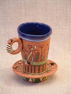 Американская художница по керамике Natalya Sots делает замечательную веселую керамическую посуду и другие объекты интерьера,которые способны* оживить* любую кухню,и любое чаепитие сделать сказочным и веселым!