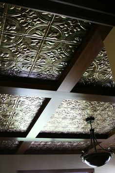 Love the tin look panels in the coffered ceiling