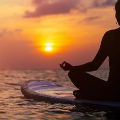 Yoga on a stand-up-paddle board at sunset. Does it get any more peaceful than that?
