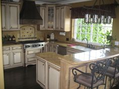 Tuscan Kitchen, Completely remodeled small Kitchen but big on style...custom color glazed maple cabinets with granite countertops & full gra...