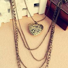https://www.milestonekeepsakes.com/products/2016-new-fashion-hot-selling-wholesale-vintage-peach-heart-patterns-layered-necklace-multilayer-sweater-chain-66n52