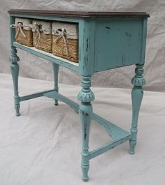 We painted her French Teal with an antique white interior and added some pretty storage baskets, perfect for a chic office, bedroom or bathroom storage.
