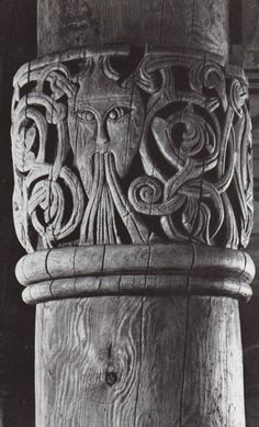 Stave church at Hurum in Valdres, capital with carved head. Despite being a Christian church, leftover Viking gods appear in the capital sculpture.