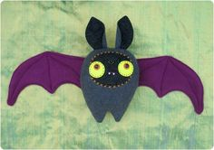 DIY Bat Plushie - A bat constructed from fleece and quilting fabric. Perfect gift for a Halloween baby, or for that special someone.
