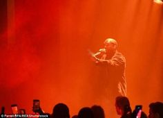 Kanye West lashes out with a middle finger to critics of fashion show