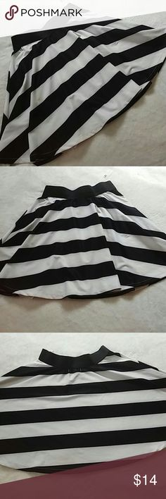"""NWT- B & W Stripe Skirt NWT from YA Los Angeles- black and white stripe skater skirt. Thick black elastic waistband. 12"""" unstretched. Cotton/rayon blend. About 17"""" long. Sewn in liner. Ya Los Angeles Skirts Circle & Skater"""