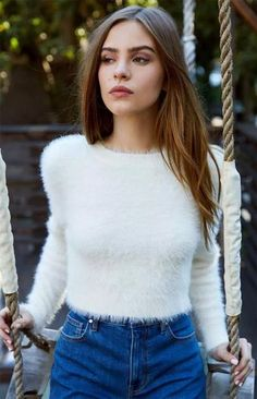 Give your fall wardrobe a cozy, fashion-forward update with the Fuzzy Cropped Pullover Sweater. Kendall and Kylie deliver this pullover sweater complete with a soft and fuzzy fabric, crew neckline, long sleeves, and a cropped fit. Girls Fashion Clothes, Winter Fashion Outfits, Look Fashion, Girl Fashion, Bridget Satterlee, Fluffy Sweater, Angora Sweater, Cropped Tumblr, Elite Model Look