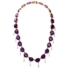 "Amethyst Diamond Gold Fringe Necklace. This aesthetically breath-taking antique (Ca. 1900s) necklace resplendent in 24 evenly colored, highly translucent oval-faceted amethysts and 13 round-faceted diamonds is crafted in solid 18K yellow gold, weighs approx. 40.5 grams and measures approx. 16 1/4"" long, c 1900s"