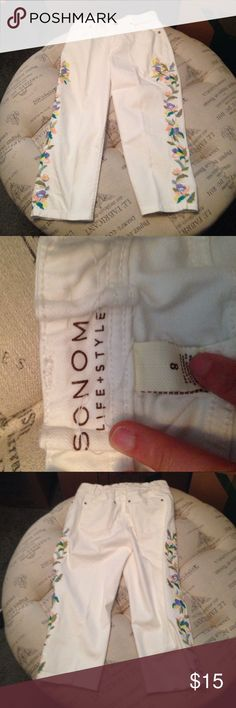 Sonoma white Capri pants with flower appliqué In good condition Sonoma white Capri pants with flower appliqué size 8. Please note that these pants were tailored as shown in the last picture - this can be undone to go back to the original size Sonoma Pants Capris