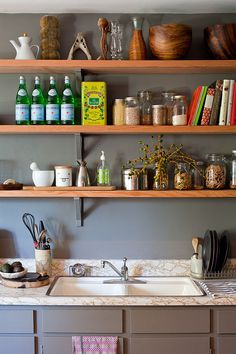 Open wooden shelves for the shabby chic style kitchen [Photography: Teri Lyn Fisher]