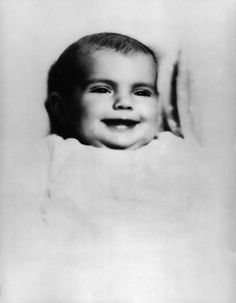 The first formal portrait of Jacqueline Lee BOUVIER was made at the age of five months and shortly before her christening. She is wearing her maternal grandfather (James T Lee) christening robe. It was bought in Paris and fashioned of gossamer lawn strewn with miniature hand embroidered bouquets.Jacqueline was christened the day before christmas in 1929, at the church of St Ignatius Loyola in New York.
