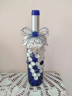 Custom hand painted/designed decorative wine bottle for centerpieces in home decor, vases, or to an extra touch of color in the room Empty Wine Bottles, Recycled Wine Bottles, Wine Bottle Corks, Glass Bottle Crafts, Painted Wine Bottles, Lighted Wine Bottles, Diy Bottle, Painted Wine Glasses, Bottle Lights