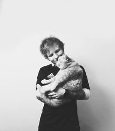 Ed Sheeran holding a cat. He's on my favorite persons list right now.