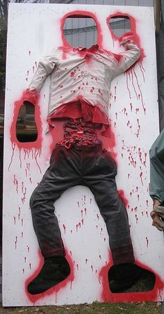 Love it!! Make a zombie toss game or photo op at your Halloween party