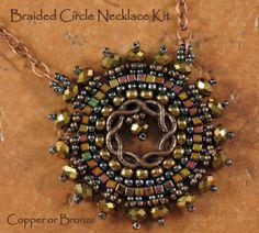 Circular brick stitch pendant - love the metal component.