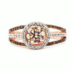 The floating halo setting on this unique solid 14K rose (pink) gold engagement ring with brown diamonds enhances the center stone which appears