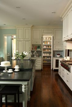kitchen design with stone counter tops and hard wood flooring