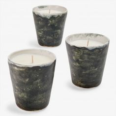 Ash Cloud Black Natural Soy Wax Candle    Exclusively at ABC, hand-formed ceramics by Icelandic artist Bjarni Sigurdsson are filled with clean-burning natural soy wax candles by Linnea's Lights. Ceramic cups are coated in up to three layers of lacquer, finished in a natural glaze made from the volcanic ashes of the Eyjafjallajökull eruption. A stone black glaze envelops masculine scents: Santal, Sea Salt, Vetiver. Giving light to the virtue of slow design, each candle is infused with pure…