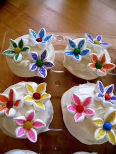 marshmallow flowers - cut mini marshmallows in half, dip in colored sugar, arrange petals on dab of melted white choc., use m&m of skittle for center