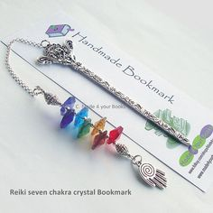 Reiki seven Chakra Crystal metal Bookmark This bookmark has been made with a set of seven octagonal crystals to represent the seven main chakra points, finished with a pewter spiral healing hand charm. Reiki Chakra, Chakra Crystals, Wire Bookmarks, Reiki Practitioner, Cellophane Wrap, Healing Hands, Solar Plexus Chakra, Throat Chakra, Clay Creations