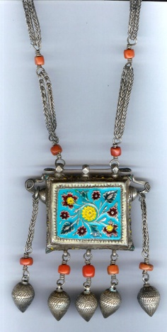 One of the most unusual pieces. This wonderful Khol container having enameling on reverse filigree and inlay of garnet, rubies and emeralds as well as a full functioning make up containers inside.