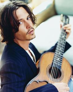 Even though he completely ruined Willy Wonka and The Mad Hatter, he's still nice to look at -- Johnny Depp