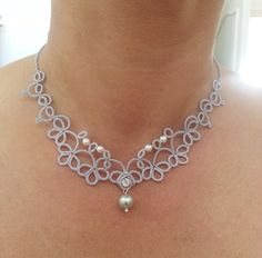Delicate silver grey tatted necklace, worked after my own pattern in high quality coton thread. The pearls are inserted while making the lace.