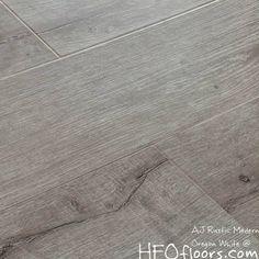 "AJ Trading AJ Trade Mega Clic Oregon White reclaimed oak 12.3 mm x 7"" wide board, wire brushed embossed laminate AC3 rating, available at HFOfloors.com."