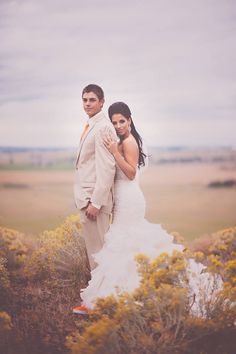My husband and I on our wedding day! Wearing the Divina gown by Maggie Sottero!...Photography credit: portraitsbyandra.com