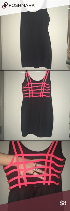 Black bodycon dress Black bodycon mini dress. Neon pink bondage style back detail. Back is cutout & transparent. Size Large. From Charlotte Russe 👌🏼 worn once & is now too big for me. Great girls night out dress 🤘🏼😎🍹🥂💋 priced to make space in my closet, make an offer Charlotte Russe Dresses Mini