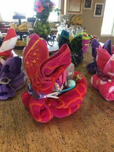 """Bunnys for my honeys! I made bunnys out of beach towels than stuffed the """"pocket"""" with flip-flops,swimsuit, and swim goggles.Nana's idea for an Easter Basket.better than candy!: basket ideas for teachers Easter 2018, Easter Party, Easter Dinner, Easter Table, Hoppy Easter, Easter Eggs, Easter Bunny, Easter Food, Diy Ostern"""