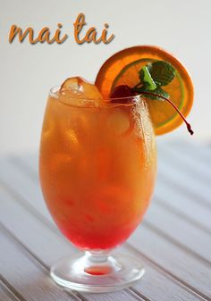 Mai Tai (1 park dark rum 1 part light rum 2 parts orange juice 1 part triple sec 1/2 part lime juice Splash of grenadine)