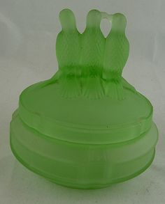 green satin Art Deco powder jar, circa 1930's I have one of these with a clown on top…oh satin glass in green