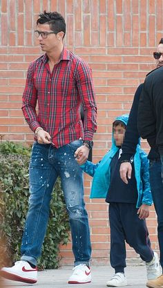"""Cristiano Ronaldo is seen picking up his son Cristiano Ronaldo jr from school on January 30, 2015 in Madrid, Spain. """