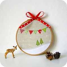 cute ornament, Christmas decoration (made in a larger hoop), or use the same idea and applique it to a pillow or kitchen towel.