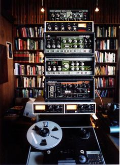 Quite a large stack of roland space echoes and other tape delays, plus a reel to reel recorder... endless sounds from somtehing that may recall a piece of furniture!