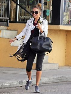 Inner rock star: Nicole Richie wears a studded, white biker jacket as she hits the gym the morning after the Golden Globes