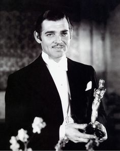 "Clark Gable receives the Oscar for his performance in ""It Happened One Night"", at the 7th Academy Awards, February 1935."