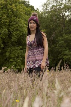 Maroon and natural bobbl hat in the fields