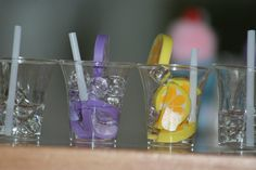 American Girl Doll Drinks! DIY: They are so simple, small plastic glass, cute fruit erasers, clear glass beads to look like ice cubes, and coffee stirrers for the straws, and clear tacky glue poured o