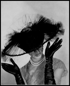 Model is wearing a black sheer tulle hat by Paulette, gloves by Roger Faré, photo by Georges Saad, 1959. #BlackTulleHat #VonGiesbrechtJewels