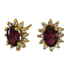 Two Ct Tw Ruby Ovals Surrounded By Diamonds 14Kt Yellow -  These wonderful stud earrings have 2.00ct of oval shape rubies and 0.36ct of round accent diamonds.  Beautiful red oval rubies are surrounded by brilliant diamonds in these 14K yellow gold earrings, which have a post and push-on closure. There are diamonds and oval-shaped rubies in these classic and sophisticated earrings. Tailored for everyday wear, they are extremely well-priced and make a great gift.  Dacarli has been...