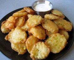 Fried Pickles 1c beer 2 eggs 2c flour Pour oil in lg skillet. Heat oil to 350 degrees. Strain pickles in sm colander. Whisk yolks, 3/4 cup  beer. Season the mixture with S Whisk in enough flour to form a batter. If the batter is too thick + the remaining beer to thin the batter. Dip pickles one at a time using tongs into  batter & place in oil Fry pickles 2 min flipping pickles after 1 min Place pickles lined plate & season. Serve w/ Ranch Dressing.