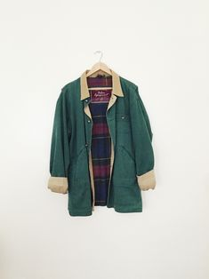 green canvas jacket with corduroy collar and plaid lining